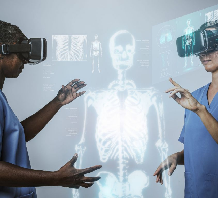 Doctors wearing VR simulation with hologram medical technology